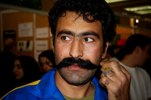 Man twirling his mustache